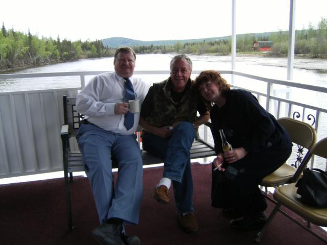 Robert Boles, Howard Colbert and Linda Boisseau sitting on the upper deck enjoing an after dinner drink