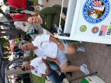 Ron Price, Art Marshall and Amy at the information desk during the Bike Night