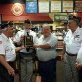 Plaque presentation to the Golden Corral Restaurant manager. From left to right: Pete Schwarz, Larry Tiller, Kevin Wilson, Ron Price