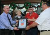 For their help on Military Appreciation Day a plaque is presented to KEN, Gen.Mgr. and GILL store Mgr. by Robert Carter, DAV and Commander Sam Smith of Chapter 17, Gainesville.