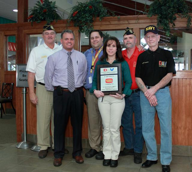 A plaque is presented to the Cumming, GA Golden Corral rest. for their help on Military Appreciation Day.