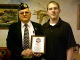Commander Bolton giving the Assistant Manager of Golden Corral a Appreciation Award.