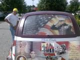 Dave Simpler looking over the art work on a fellow veterans vehicle.