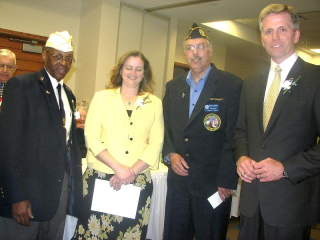 Kathy receives award from new State Commander George Mathis (Left) and Chapter 1 Commander Richard Fournier (to her right) and Guest Speaker Charlie Summers