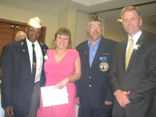 Sonja receives award from new State Commander George Mathis (Left) and Chapter 1 Commander Richard Fournier to her right and guest speaker Charlie Summers