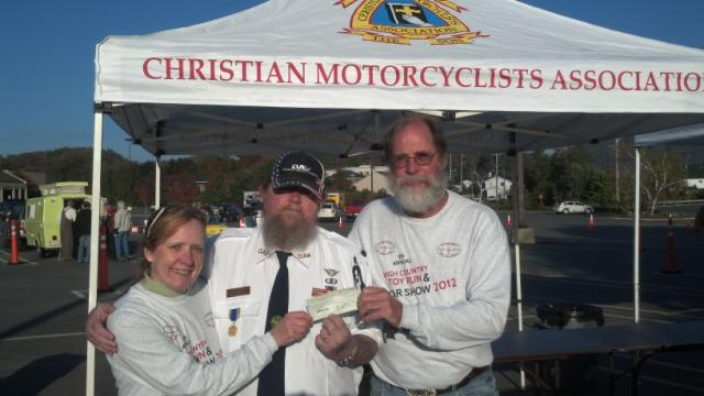 Past Commander Bernie Lee presenting our donation to Watauga Toy Run.