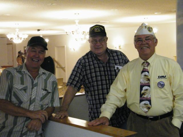 Craig Lane, Vern Holsclaw and John Inman smile brightly for the camera after Oct meeting.