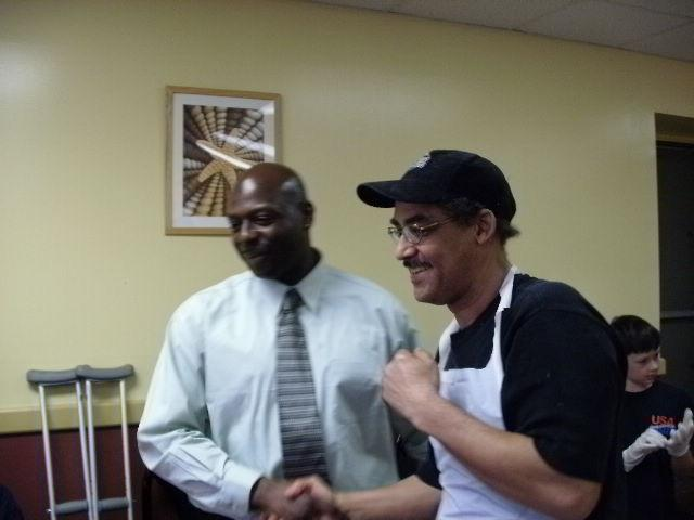 Owner of Steel City Ribs, Rander Thompson receives thank you from Fred Johnson Founder/CEO of Heroes Today.
