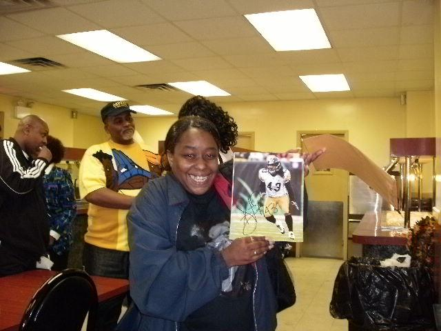 OEF/OIF Veteran Stephanie Robinson wins a donated signed picture of Steeler Troy Polamalu.