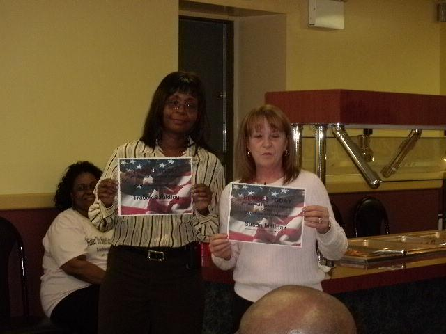 Volunteers Tracy and Susan receive Letters of Appreciation from Heroes Today for their efforts in making the Homeless Veteran Dinners a success.