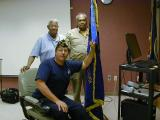 Commander Havelka, attached the 2007 2008 Membership Streamer with the help Life Member Floyd C. Coles Jr. and New DAV, VAVS Rep. from the Highland Drive VAMC, Joseph Backers.