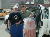 Commander Havelka receiving help from Mike at Shepherds Heart while dropping off donated clothing.