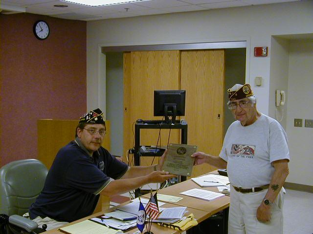 "Commander Havelka presented Mr. Gomberg with the ""2008 VOLUNTEER OF THE YEAR AWARD"" for his donating over 10,000 combined hours in serving veterans and their families over the years."