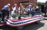Parade Float trailer with members of Chapter 22 and Auxiliary along with VFW and American Legions members.