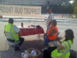 Workers taking a break from the road block to raise funds for the DAV 56 in Linden, TN