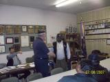 Commander Johnson presents a plaque to Chaplain Edmond Jones for his service of many years to the chapter.