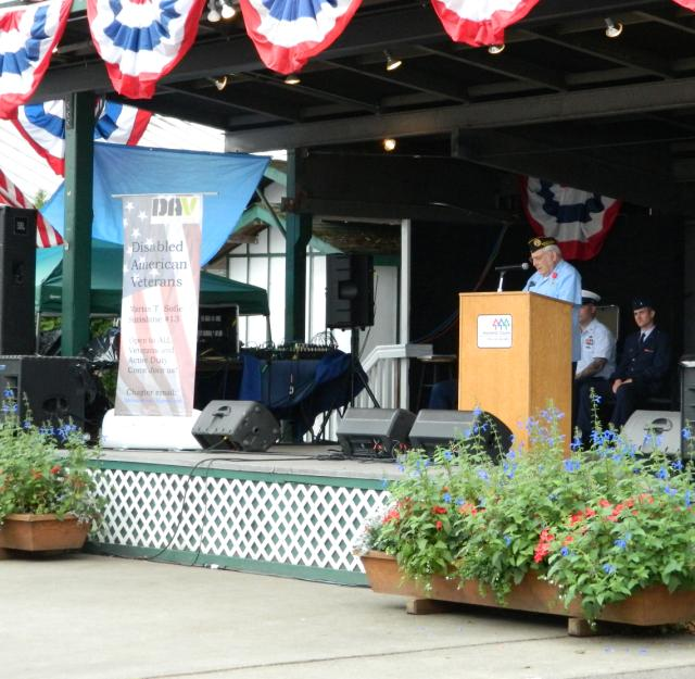 Jack Van Eaton giving presentation for Armed Forces Day at Evergreen Fair 2015. Notice our DAV chapter Banner on stage and also Jack is World War II veteran and member of our chapter