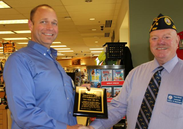 Awarded Kevin with a plaque stating how much we appreciate their support of all our charity fund raising events. In photo is Commander Gregg Michael and store Manager Kevin Hauser