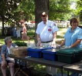 Commander Bob Irving Serving Roast Beef dinner at King Day.