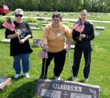 commander Noel Irving, Mary Roberts and Christina Irving take time out and pose for a picture while placing Flags on Veterans Graves.