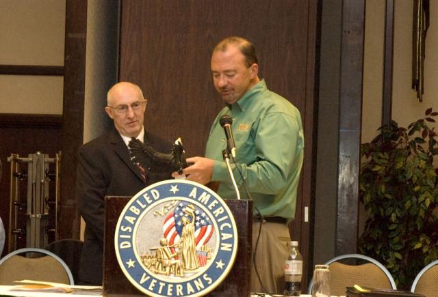 Supervisory NSO Tony Craig presents the Service Award to VA DRO Jerry Shutt.