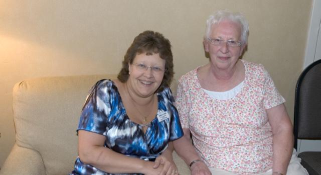 2010-11 DAVA Commander Debra Loetz and DAVA Treasurer Charlotte Loetz light up the room.