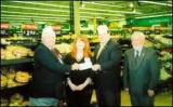 Commander Larry Johnson and SVC Bob Burke receive a check from Rochester store manager at Wal*Mart. Adjutant Ron Reilly looks on.