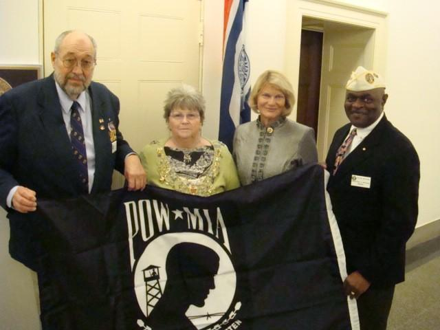 DAV Dept Commander Gary Lucus, DAVA Dept Commander Peggy Lucus and DAV Dept Adjutant Floyd Watson, Jr presented a POW/MIA Flag to Representative Cynthia Lummis on February 24,2009